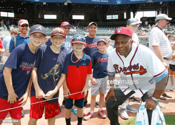 Former Braves player Ralph Garr takes a photo with some young fans prior to the MLB game between the Atlanta Braves and the Miami Marlins on August 6...