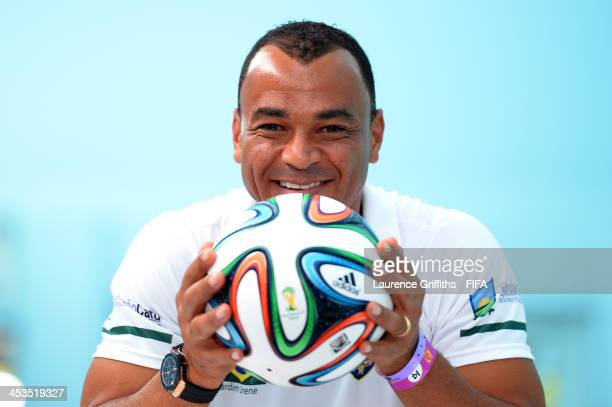 Former Brazil footballer Cafu poses with the adidas Brazuca official match ball for the 2014 FIFA World Cup Brazil during previews ahead of the Final...
