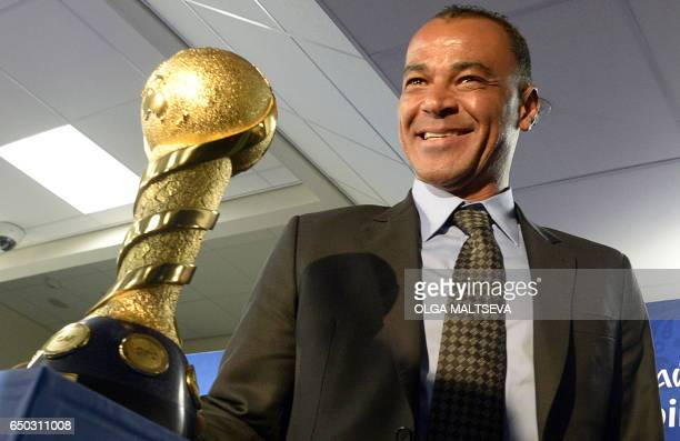 Former Brazilian football player Marcos Evangelista de Morais known as Cafu poses with the FIFA Confederations Cup 2017 winners trophy after a...