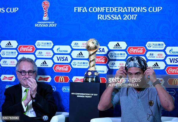Former Brazilian football star Ronaldinho and the president of the Mexican Football Federation Decio de Maria attend a press conference on the eve of...