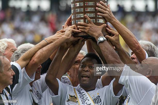 Former Brazilian footballer Edson Arantes do Nascimento aka 'Pele' ambassador of the 2014 World Cup ceelbrates with former team players during the...