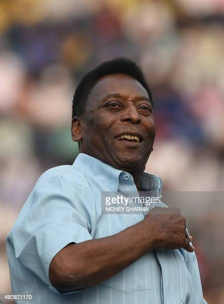 Former Brazilian footballer Pele greets the crowd before the start of the Under17 boys final match of the Subroto Cup in New Delhi on October 16 2015...