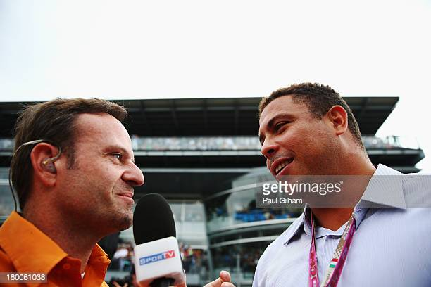 Former Brazilian footballer Ronaldo is interviewed by former F1 driver Rubens Barrichello before the Italian Formula One Grand Prix at Autodromo di...