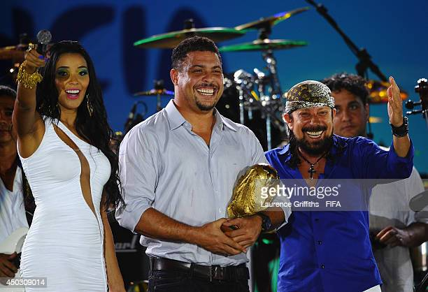 Former Brazilian footballer Ronaldo shows off the World Cup during the 2014 FIFA World Cup Fan Fest Kick off Event in Fortaleza on June 8 2014 in...