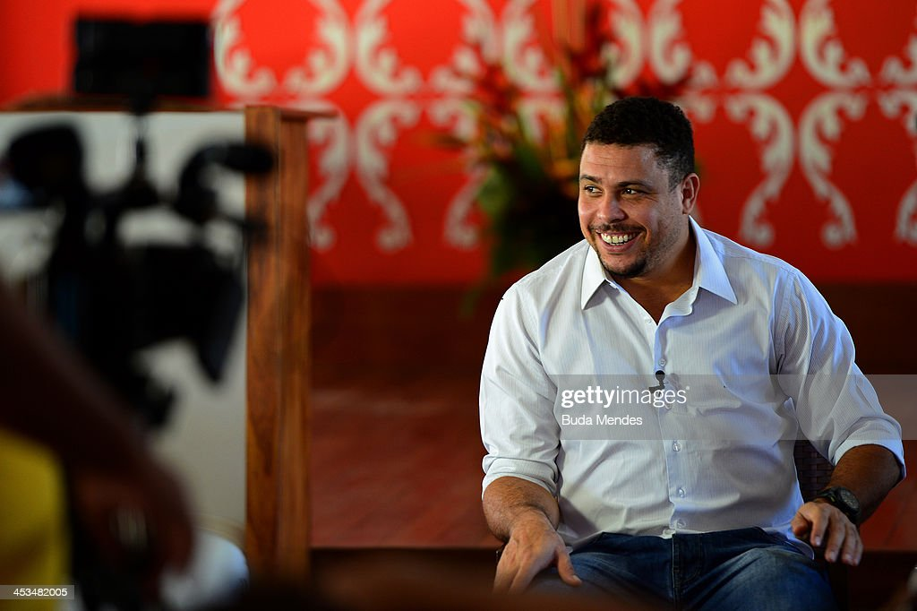 Former Brazilian footballer Ronaldo smiles during an interview ahead of the Final Draw for the 2014 FIFA World Cup at Costa do Sauipe Resort on December 4, 2013 in Costa do Sauipe, Brazil.