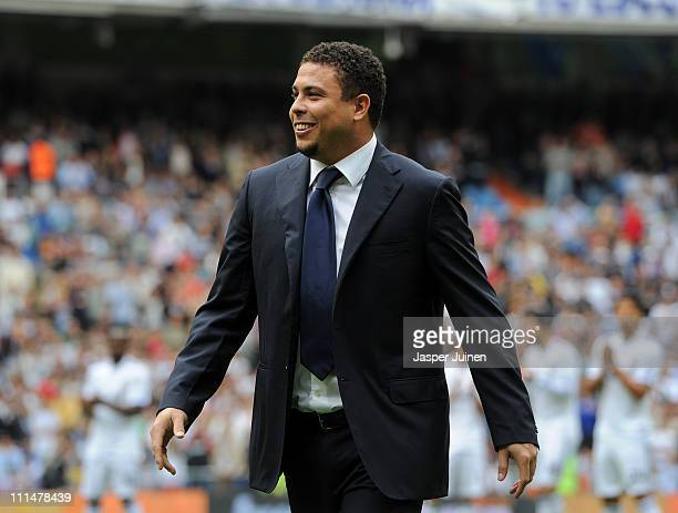 Former Brazilian international Ronaldo looks on from the pitch prior to the start of the la Liga match between Real Madrid and Sporting Gijon at...
