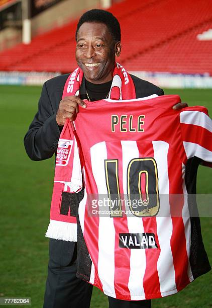 Former Brazilian national footballer Pele poses with a Sheffield United number 10 football shirt at Bramhall Lane stadium on November 7 2007 in...