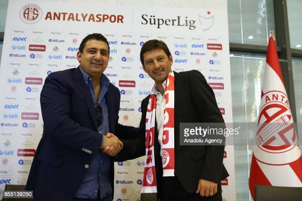 Former Brazilian player and head coach Leonardo Nascimento de Araujo shakes hands with President of Antalyaspor Ali Safak Ozturk after signing for...
