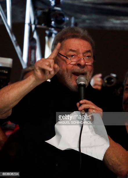 Former Brazilian President Luiz Inacio Lula da Silva delivers a speech as he takes part in a protest during a national strike against the...
