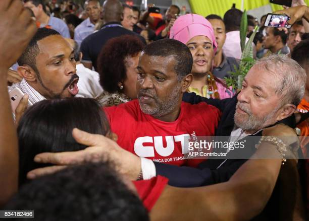 Former Brazilian President Luiz Inacio Lula da Silva greets supporters during the opening rally of his bus tour through the northeast of the country...