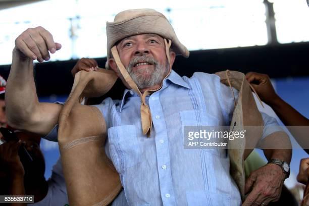 Former Brazilian President Luiz Inacio Lula da Silva meets farmers during his 'Lula for Brazil' bus tour of 20 cities in northeastern Brazil to...