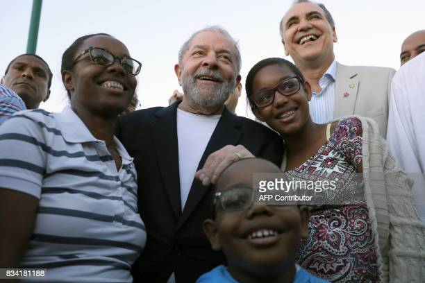 Former Brazilian President Luiz Inacio Lula da Silva poses for a picture with supporters during the opening rally of his bus tour through the...