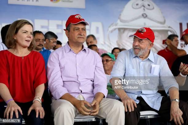 Former Brazilian President Luiz Inacio Lula da Silva sits with senator Gleisi Hoffmann and the governor of Bahia Rui Costa during a meeting with...