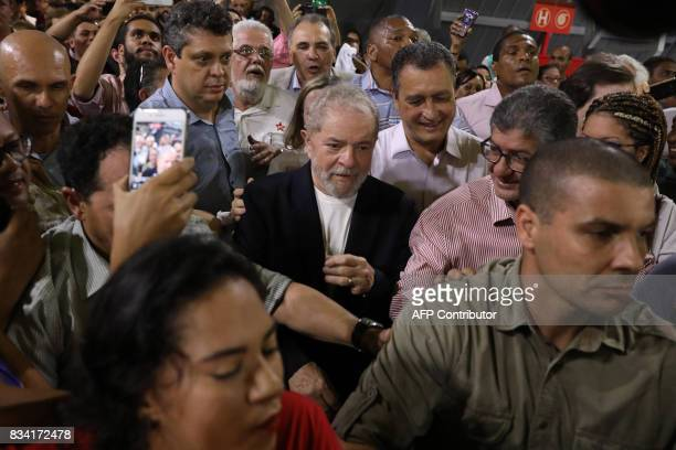 Former Brazilian President Luiz Inacio Lula da Silva walks amid supporters during the opening rally of his bus tour through the northeast of the...