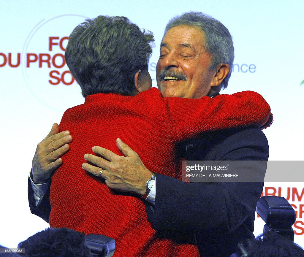 Former Brazilian president Lula Da Silva (R) embraces current Brazil's president Dilma Rousseff upon her arrival at the Forum of Social Progress on December 11, 2012 in Paris. Dilma Rousseff is on a two-day official visit toFrance. AFP PHOTO POOL REMY DE LA MAUVINIERE