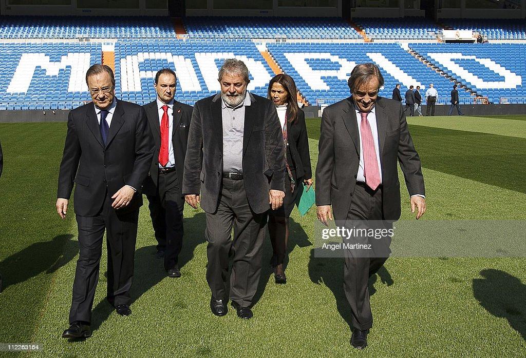 Former Brazilian President Lula da Silva (C) walks with President Florentino Perez (L) and board member Luis Blasco of Real Madrid during a visit to the Estadio Santiago Bernabeu on April 16, 2011 in Madrid, Spain.