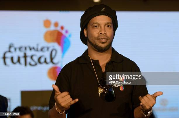 Former Brazilian professional footballer Ronaldinho gestures during a news conference to announce the second season of the Premier Futsal Football...