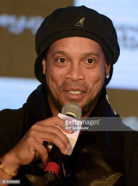 Former Brazilian professional footballer Ronaldinho speaks during a news conference to announce the second season of the Premier Futsal Football...