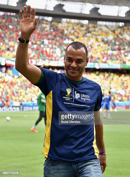 Former Brazilian soccer player Cafu waves to fans before the 2014 FIFA World Cup Brazil Group A match between Brazil and Mexico at Castelao on June...