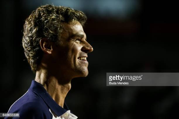 Former brazilian tennis player Gustavo 'Guga' Kuerten looks on during theATP World Tour 500 Rio Open tennis final match between Dominic Thiem of...