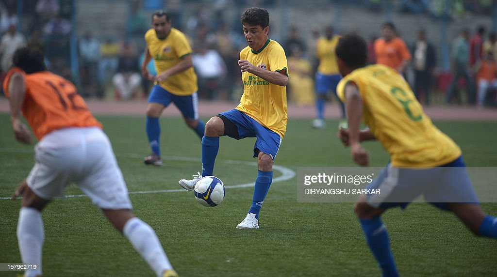 Former Brazilian word cup champion footballer Bebeto tries to control the ball during an exhibition match between Brazilian Masters and Indian All Stars in Kolkata on December 8, 2012. The Brazilian team won the match by 3-1. AFP PHOTO/ Dibyangshu SARKAR