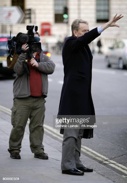 Former British Ambassador to the US Sir Christopher Meyer hails a taxi as he leaves after giving evidence to the Iraq inquiry at the Queen Elizabeth...