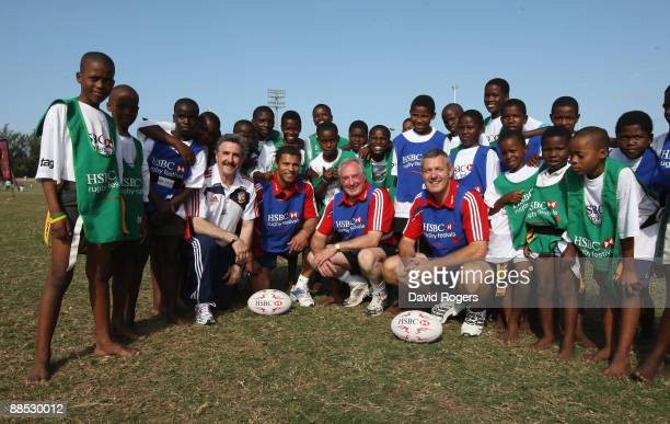 Former British and Irish Lions players Gareth Davies Jason Robinson Gareth Edwards and Gavin Hastings pose with local children during the HSBC Durban...