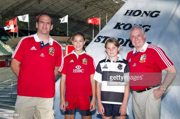 Former British Irish Lions players Martin Johnson who was captain and Gareth Edwards present team jerseys to youngsters participating in a HSBC...