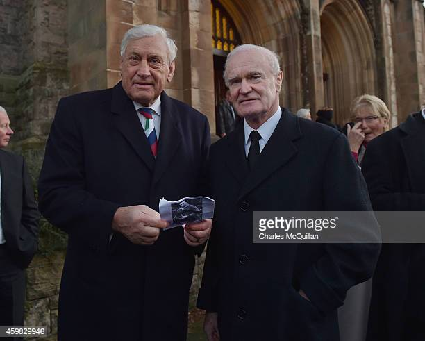 Former British Lions Willie John McBride and Mike Gibson attend the thanksgiving service for Ireland rugby legend Jack Kyle as it takes place at...