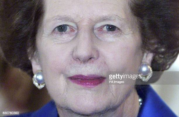 Former British Prime Minister Baroness Thatcher poses for a picture as she meets with President of Croatia Stjepan Mesic in London Tuesday December...