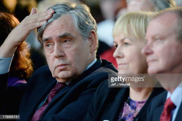 Former British Prime Minister Gordon Brown fixes his hair during a United Labour event at the Pearce Institute on September 2 2013 in Glasgow...