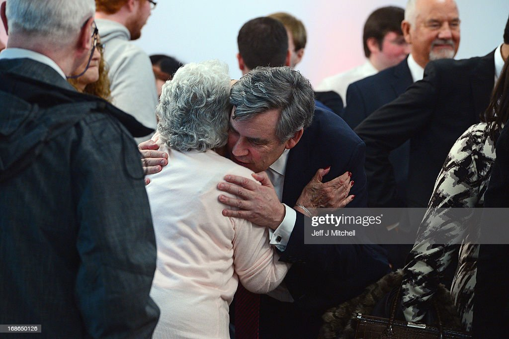 Former British Prime Minister <a gi-track='captionPersonalityLinkClicked' href=/galleries/search?phrase=Gordon+Brown&family=editorial&specificpeople=158992 ng-click='$event.stopPropagation()'>Gordon Brown</a> hugs a woman after speaking during the Scottish Labour launch to keep Scotland as part of the UK on May 13, 2013 in Glasgow, Scotland. The party launched its 'United with Labour' campaign today which it says offers the people of Scotland a ''different view ''on the country's future.