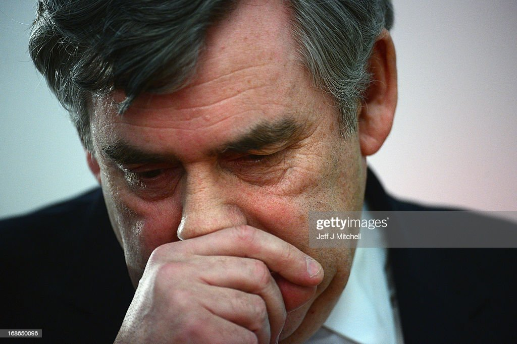 Former British Prime Minister <a gi-track='captionPersonalityLinkClicked' href=/galleries/search?phrase=Gordon+Brown&family=editorial&specificpeople=158992 ng-click='$event.stopPropagation()'>Gordon Brown</a> reacts during the Scottish Labour launch to keep Scotland as part of the UK on May 13, 2013 in Glasgow, Scotland. The party launched its 'United with Labour' campaign today which it says offers the people of Scotland a ''different view ''on the country's future.