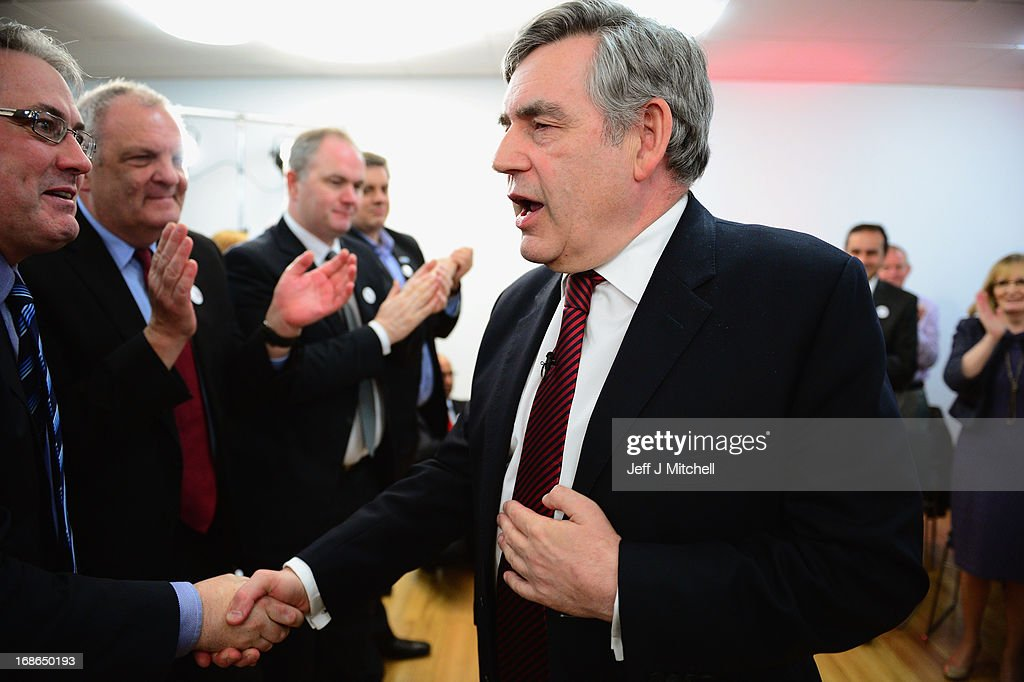Former British Prime Minister Gordon Brown shakes hands after speaking during the Scottish Labour launch to keep Scotland as part of the UK on May 13, 2013 in Glasgow, Scotland. The party launched its 'United with Labour' campaign today which it says offers the people of Scotland a ''different view ''on the country's future.