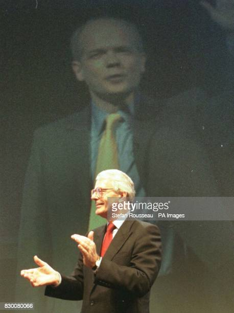 Former British Prime Minister John Major applauds Tory leader William Hague as he makes his entrance at this year's Conservative Party Conference in...