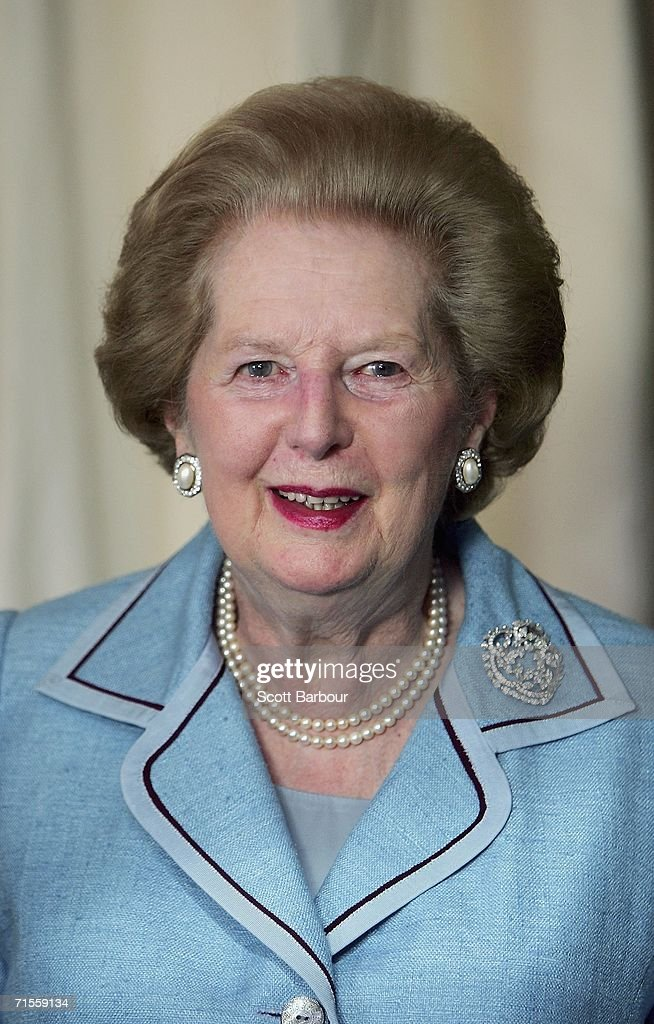 Former British Prime Minister <a gi-track='captionPersonalityLinkClicked' href=/galleries/search?phrase=Margaret+Thatcher&family=editorial&specificpeople=159677 ng-click='$event.stopPropagation()'>Margaret Thatcher</a> poses next to a recently created portrait of herself on August 1, 2006 in London, England. The portrait of Lady Thatcher, constructed from silk chiffon on rusted iron is by award-winning young designer Benjamin Shine.