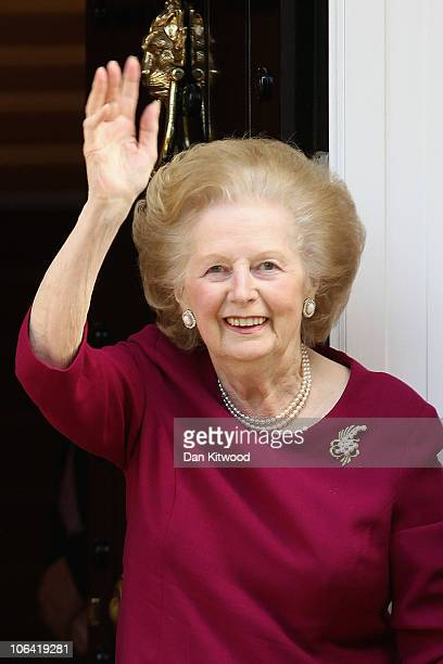 Former British Prime Minister Margaret Thatcher waves to the press at her home after leaving Cromwell Hospital on November 1 2010 in London England...
