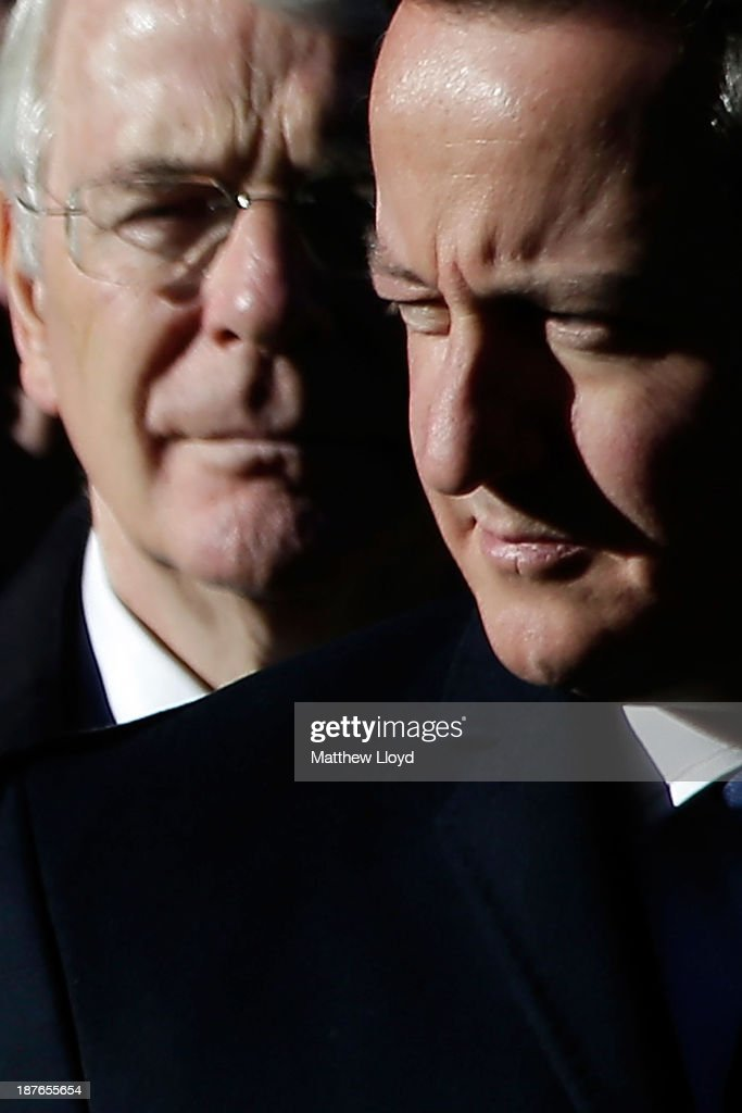 Former British Prime Minister Sir <a gi-track='captionPersonalityLinkClicked' href=/galleries/search?phrase=John+Major&family=editorial&specificpeople=159410 ng-click='$event.stopPropagation()'>John Major</a> and current British Prime Minister <a gi-track='captionPersonalityLinkClicked' href=/galleries/search?phrase=David+Cameron+-+Politician&family=editorial&specificpeople=227076 ng-click='$event.stopPropagation()'>David Cameron</a> stand in front of the Cenotaph on Whitehall during the annual Remembrance Sunday service on November 10, 2013 in London, United Kingdom. People across the UK gathered to pay tribute to service personnel who have died in the two World Wars and subsequent conflicts, as part of the annual Remembrance Sunday ceremonies.