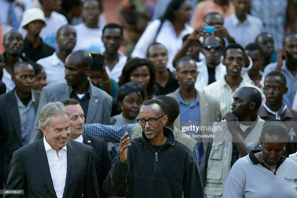 Former British Prime Minister <a gi-track='captionPersonalityLinkClicked' href=/galleries/search?phrase=Tony+Blair&family=editorial&specificpeople=118622 ng-click='$event.stopPropagation()'>Tony Blair</a> (L) and Rwandan President <a gi-track='captionPersonalityLinkClicked' href=/galleries/search?phrase=Paul+Kagame&family=editorial&specificpeople=601832 ng-click='$event.stopPropagation()'>Paul Kagame</a> (C) lead the Walk to Remember into Amahoro Stadium during the 20th anniversary commemoration of the 1994 genocide April 7, 2014 in Kigali, Rwanda. Thousands of Rwandans and global leaders, past and present, joined together to remember the country's 1994 genocide, when more than 800,000 ethnic Tutsi and moderate Hutus were slaughtered over a 100 day period.