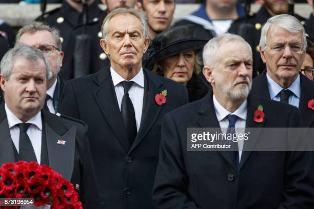 Former British prime minister Tony Blair Britain's opposition Labour Party Leader Jeremy Corbyn and former British prime minister John Major attend...