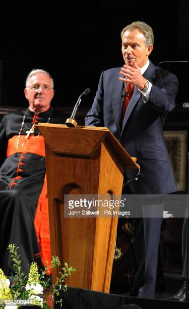 Former British Prime Minister Tony Blair during his address on Faith and Life in Britain with Cardinal Cormac Murphy O'Connor seated behind him in...