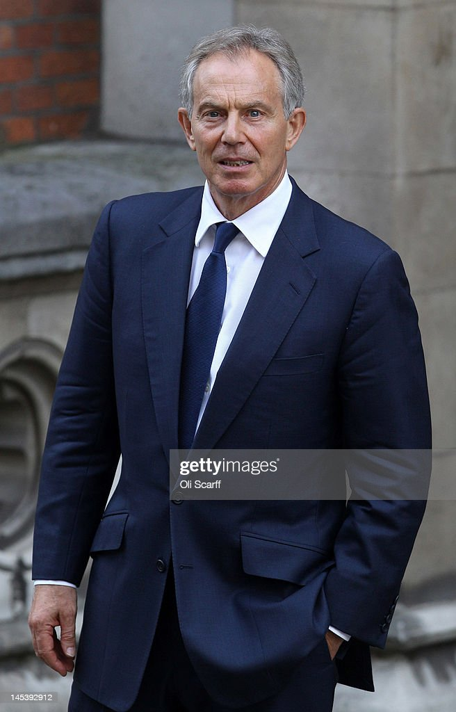 Former British Prime Minister Tony Blair leaves the Royal Courts of Justice after giving evidence to the Leveson Inquiry into media ethics on May 28...