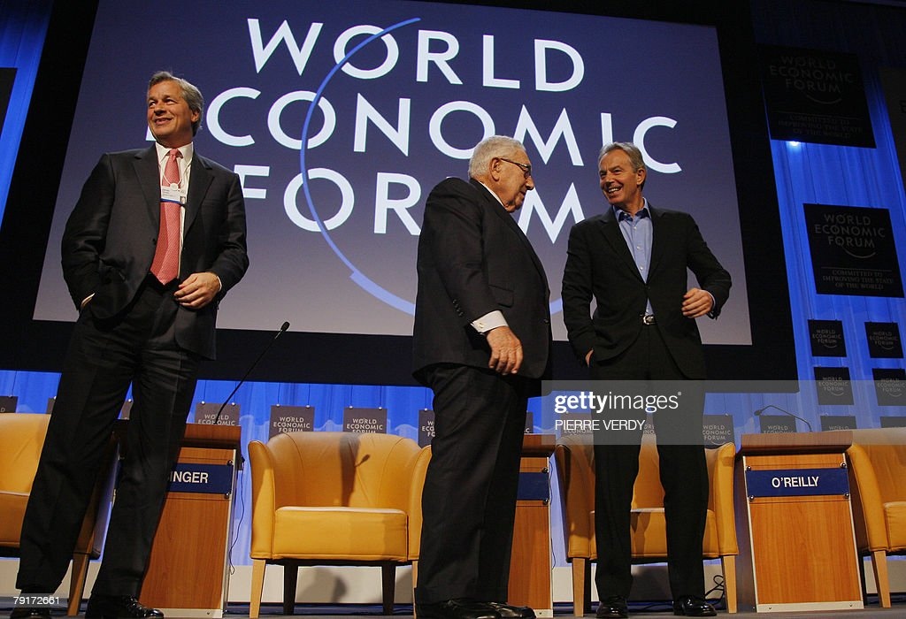 Former British Prime minister Tony Blair listens to US Henry Kissinger as James Dimon chairman and CEO of JP Morgan Chase and co smiles at the end of...