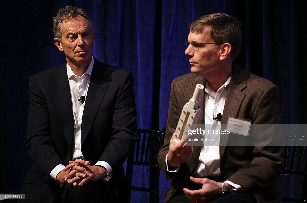 Former British Prime Minister <a gi-track='captionPersonalityLinkClicked' href=/galleries/search?phrase=Tony+Blair&family=editorial&specificpeople=118622 ng-click='$event.stopPropagation()'>Tony Blair</a> (L) looks on as New PAX, Inc. VP of Advanced Research Thomas Gielda speaks during the Khosla Ventures Cleantech Discussion May 24, 2010 in Sausalito, California. Khosla Ventures founder Vinod Khosla announced today that <a gi-track='captionPersonalityLinkClicked' href=/galleries/search?phrase=Tony+Blair&family=editorial&specificpeople=118622 ng-click='$event.stopPropagation()'>Tony Blair</a> Associates will serve as special advisors to Khosla Ventures to advocate for environmental issues and use their global relationships to assist Khosla's broad portfolio of clean technology companies maximize their effectiveness in achieving their environmental goals.