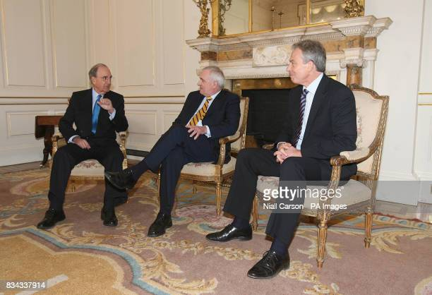 Former British Prime Minister Tony Blair right with US Senator George Mitchell left and outgoing Irish premier Bertie Ahern centre during a meeting...