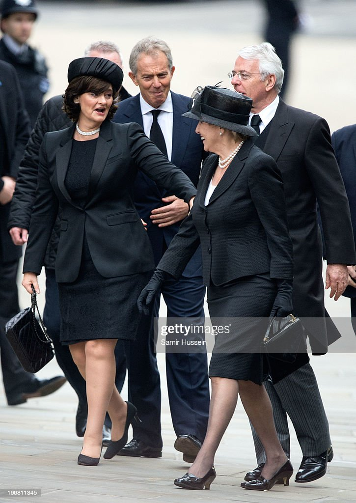 Former British Prime Ministers Tony Blair and John Major and their wives Cherie Blair and Norma Major arrive for the ceremonial funeral service of...