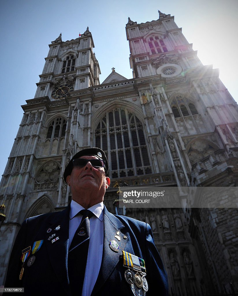 Former British soldier and veteran of the Korean war Ernie Dyson from Blackpool in northern England, poses for a photograph in front of Westminster Abbey in central London on July 11, 2013 shortly before a service marking the 60th Anniversary of the Korean War armistice. Nearly 300 elderly veterans marched through London on Thursday as Britain marked the 60th anniversary of the Korean War armistice. Service of thanksgiving at Westminster Abbey in central London, attended by Queen Elizabeth II's first cousin Prince Richard, the Duke of Gloucester, veterans minister Mark Francois, senior military representatives, the South Korean ambassador Lim Sung-Nam, and many veterans and their families.