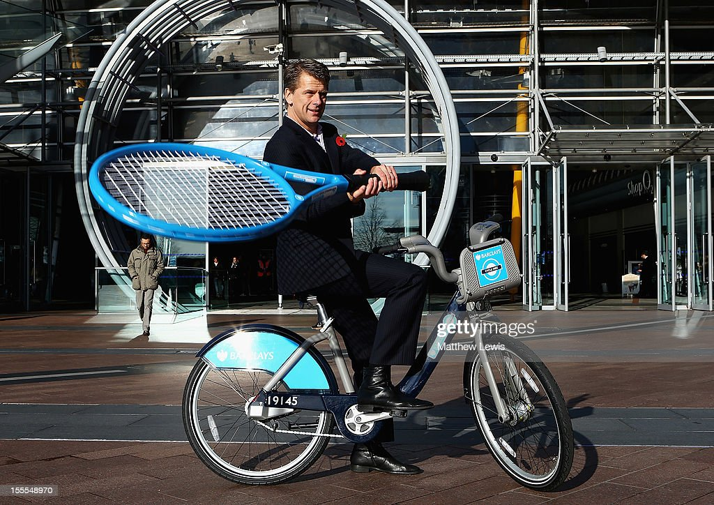 Former British tennis No. 1 Andrew Castle poses with a Barclays Cycle Hire bike on the opening day of the Barclays ATP World Tour Finals to launch 'Barclays Bikes Rewards' at the O2 Arena on November 5, 2012 in London, England. 'Barclays Bikes Rewards' offers a variety of great free deals and benefits for members and casual users of the Barclays Cycle Hire scheme across the Capital. Current offers include a discount off a HEAD tennis racket for visitors to the Fan Zone at the Barclays ATP World Tour Finals - to view the latest offers and information on how to redeem the free discounts visit facebook.com/BarclaysBikes