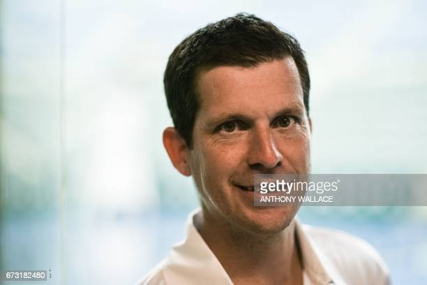 Former British tennis number one player Tim Henman poses during an interview with AFP before attending an event to launch grassroots tennis programme...