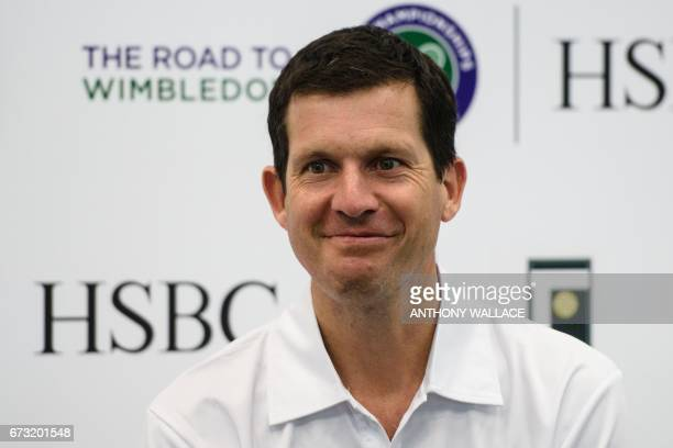 Former British tennis number one player Tim Henman smiles during an event to launch grassroots tennis programme 'The Road to Wimbledon' in Hong Kong...